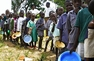 Children queue for food in Zimbabwe
